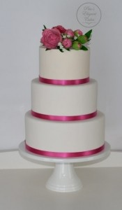 3 tier wedding cake with surag flowers in dusty pink and pink ribbon